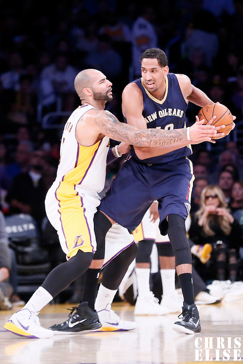 07 December 2014: Los Angeles Lakers forward Carlos Boozer (5) defends on New Orleans Pelicans center Alexis Ajinca (42) during the New Orleans Pelicans 104-87 victory over the Los Angeles Lakers, at the Staples Center, Los Angeles, California, USA.