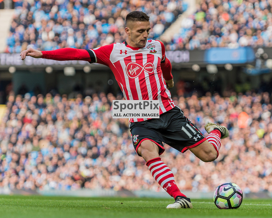 Southampton midfielder Dusan Tadic (11) gets in a shot on goal in the Premier League match between Manchester City and Southampton<br /> <br /> (c) John Baguley | SportPix.org.uk