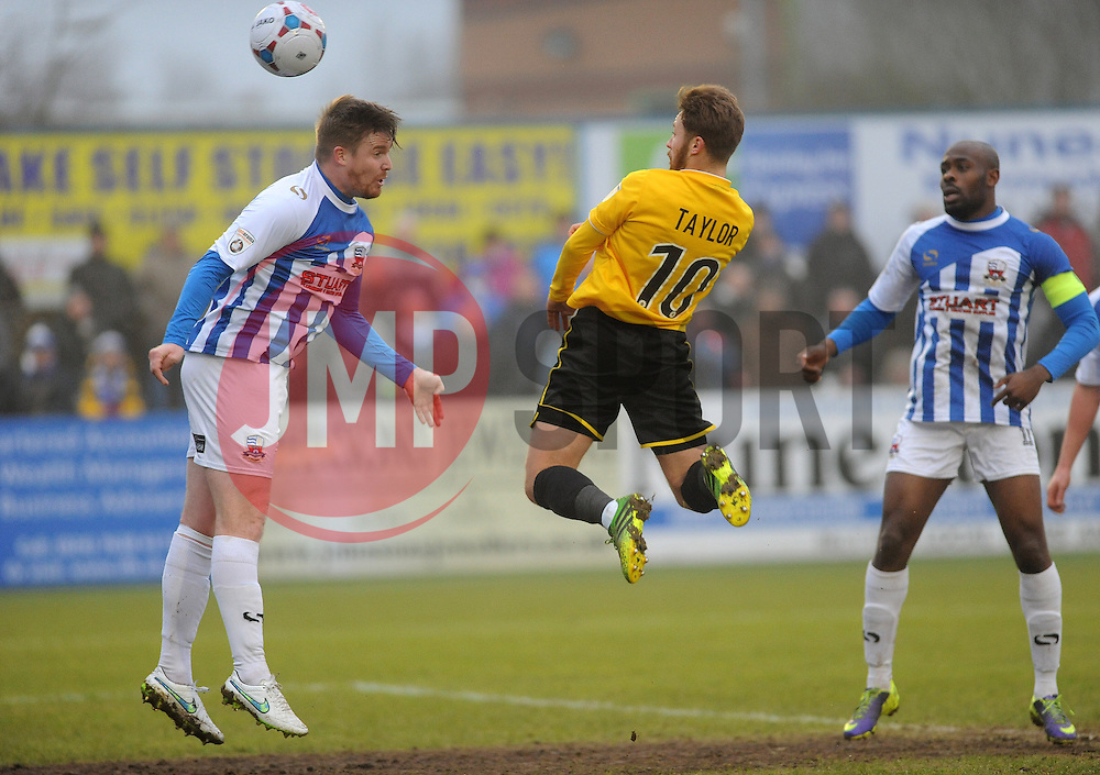 Bristol Rovers' Matty Taylor gets a header away - Photo mandatory by-line: Neil Brookman/JMP - Mobile: 07966 386802 - 04/01/2015 - SPORT - football - Nuneaton - James Parnell Stadium - Nuneaton Town v Bristol Rovers - Vanarama Conference