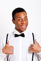 Portrait of young man gesturing thumbs up over white background