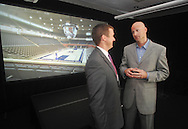 Danny White, left, executive director of the UMAA Foundation, and Mississippi head basketball coach Andy Kennedy talk in front of a screen showing a new basketball arena the university plans to build. The university announced a $150 million capital improvement campaign to build a new basketball arena and expand Vaught-Hemingway Stadium in Oxford, Miss. on Tuesday, August 9, 2011. (AP Photo/Oxford Eagle, Bruce Newman)