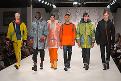 © Licensed to London News Pictures. 01/06/2014. London, England. Collection by John Moriarty from the Manchester School of Art. Graduate Fashion Week 2014, Runway Show at the Old Truman Brewery in London, United Kingdom. Photo credit: Bettina Strenske/LNP