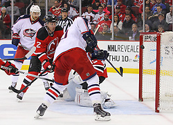 Feb 27, 2014; Newark, NJ, USA; Columbus Blue Jackets right wing Marian Gaborik (10) scores a goal on New Jersey Devils goalie Cory Schneider (35) during the second period at Prudential Center.