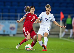 CARDIFF, WALES - Tuesday, August 21, 2014: Wales' Nicola Cousins in action against England's Jodie Taylor during the FIFA Women's World Cup Canada 2015 Qualifying Group 6 match at the Cardiff City Stadium. (Pic by David Rawcliffe/Propaganda)