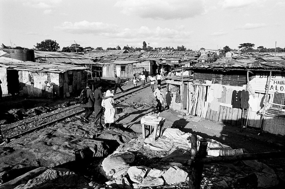 In 1917 the British Government officially gazetted the land of Kibra for Sudanese ex-soldiers and their descendants. Nubian families held a temporary license to live on the land called a Shamba Pass and had to obtain permission from Colonial authorities to expand their homes or make improvements. Since Kenya's independence, Kibera has been contested land. Nubians have never been given title deeds, have no rights to the land they've lived on, and are considered squatters even though they settled on the land generations ago.