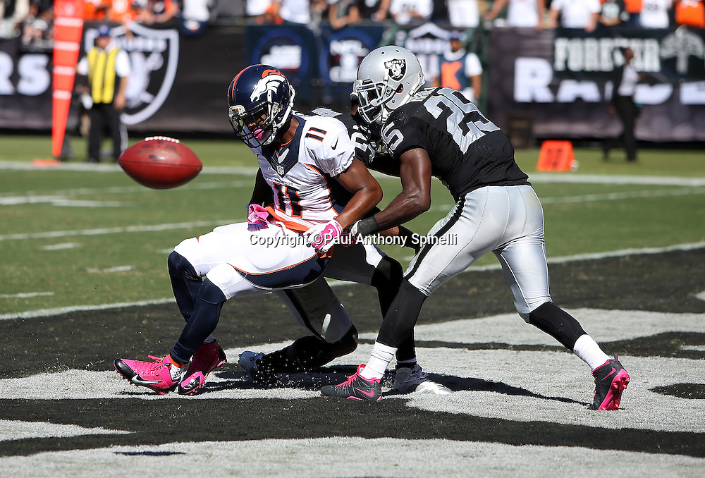 Denver Broncos wide receiver Jordan Norwood (11) is unable to catch an end zone pass broken up by Oakland Raiders free safety Charles Woodson (24) and Oakland Raiders cornerback D.J. Hayden (25) during the 2015 NFL week 5 regular season football game against the Oakland Raiders on Sunday, Oct. 11, 2015 in Oakland, Calif. The Broncos won the game 16-10. (©Paul Anthony Spinelli)