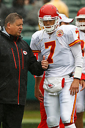 November 7, 2010; Oakland, CA, USA;  Kansas City Chiefs offensive coordinator Charlie Weis (left) talks with quarterback Matt Cassel (7) before the game against the Oakland Raiders at Oakland-Alameda County Coliseum.