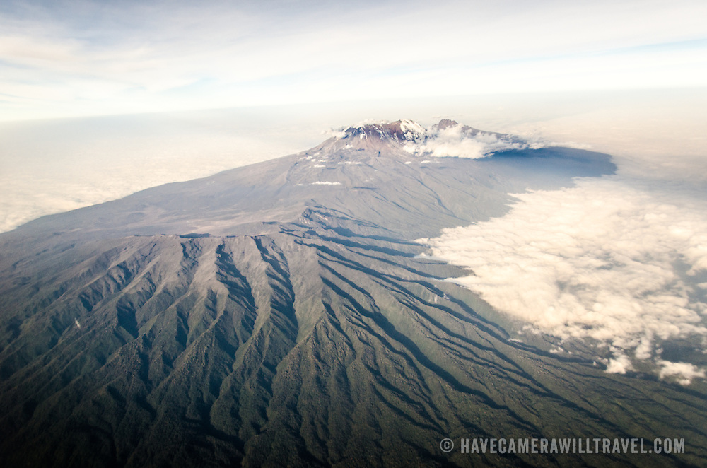 Mount Kilimanjaro Aerial View Wide Shot. An aerial view of Mount Kilimanjaro, the highest peak in Africa, with a snow-covered peak.