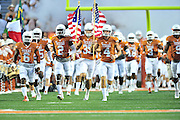 AUSTIN, TX - OCTOBER 18:  the Texas Longhorns take the field before kickoff against the Iowa State Cyclones on October 18, 2014 at Darrell K Royal-Texas Memorial Stadium in Austin, Texas.  (Photo by Cooper Neill/Getty Images) *** Local Caption ***