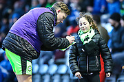 Forest Green Rovers Dayle Grubb(8) signs an autograph for a young fan during the EFL Sky Bet League 2 match between Forest Green Rovers and Port Vale at the New Lawn, Forest Green, United Kingdom on 6 January 2018. Photo by Shane Healey.