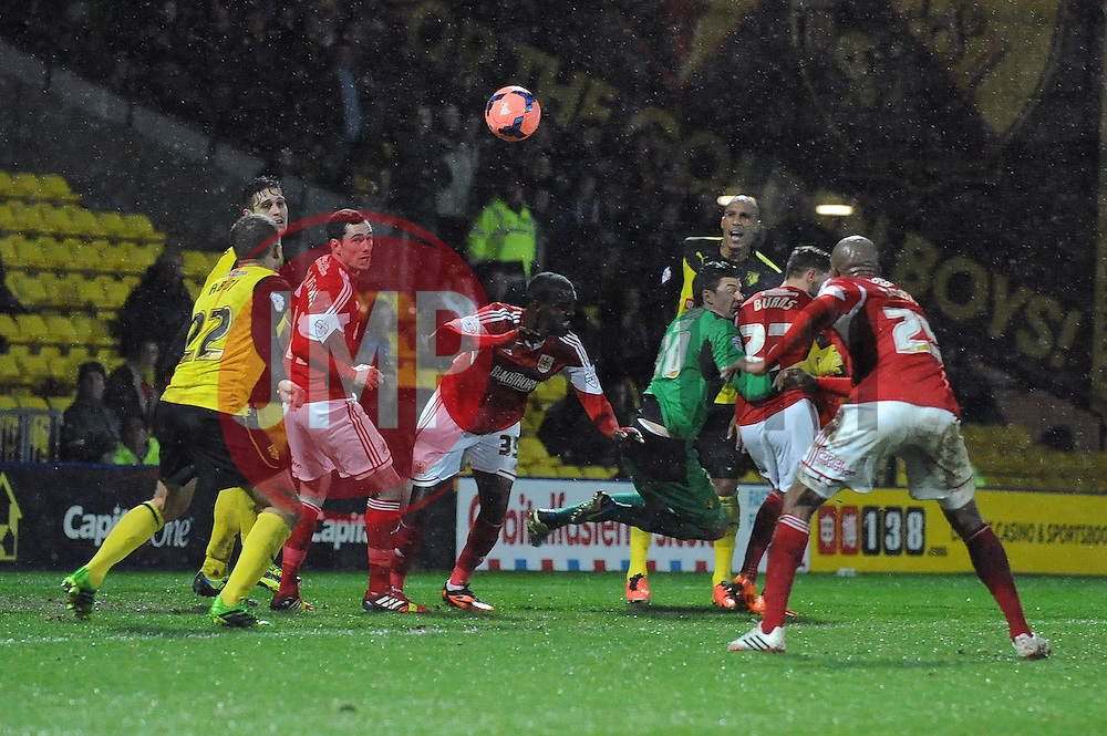 Watford's Jonathan Bond misses the ball resulting in a goalmouth scramble - Photo mandatory by-line: Dougie Allward/JMP - Tel: Mobile: 07966 386802 14/01/2014 - SPORT - FOOTBALL - Vicarage Road - Watford - Watford v Bristol City - FA Cup - Third Round - replay