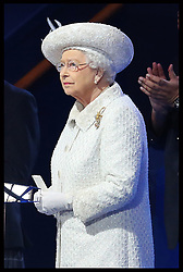 Image licensed to i-Images Picture Agency. 23/07/2014. Glasgow, United Kingdom. The Queen looks up at the fire works  after officially opening  the Commonwealth Games in Glasgow. Picture by Stephen Lock / i-Images