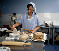 Meals on Wheels for Asian clients, preparing chapatis UK