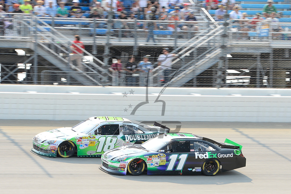 Joliet, IL - SEP 16, 2012: Denny Hamlin (11) races side by side with Kyle Busch (18) during the Geico 400 at the Chicagoland Speedway in Joliet, IL.