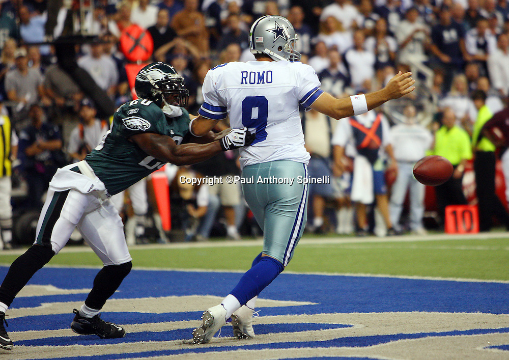 IRVING, TX - SEPTEMBER 15:  Quarterback Tony Romo #9 of the Dallas Cowboys fumbles the ball while being chased in the end zone by free safety Brian Dawkins #20 of the Philadelphia Eagles at Texas Stadium on September 15, 2008 in Irving, Texas. The Cowboys defeated the Eagles 41-37. ©Paul Anthony Spinelli *** Local Caption *** Tony Romo;Brian Dawkins