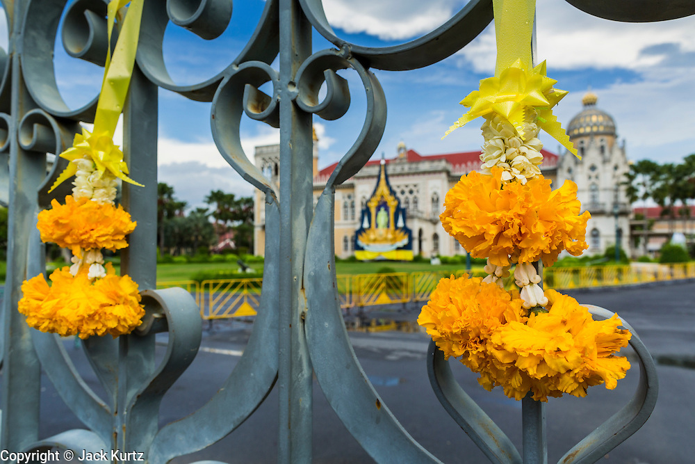 18 MAY 2014 - BANGKOK, THAILAND: Flower garlands hang on the gate of Government House in Bangkok. Suthep Thaugsuban called representatives state enterprises to a meeting at his office in Government House, normally the office of the Prime Minister, to make assignments for the coming week. Suthep has pledged to overthrow the government of interim caretaker Prime Minister Niwatthamrong Boonsongphaisan, a member of former Prime Minister Yingluck Shinawatra's inner circle. Niwatthamrong became PM after the courts ousted Yingluck. Suthep has pledged to remove the Shinawatra family from Thai politics by May 27 or he will turn himself into police to face prosecution.      PHOTO BY JACK KURTZ