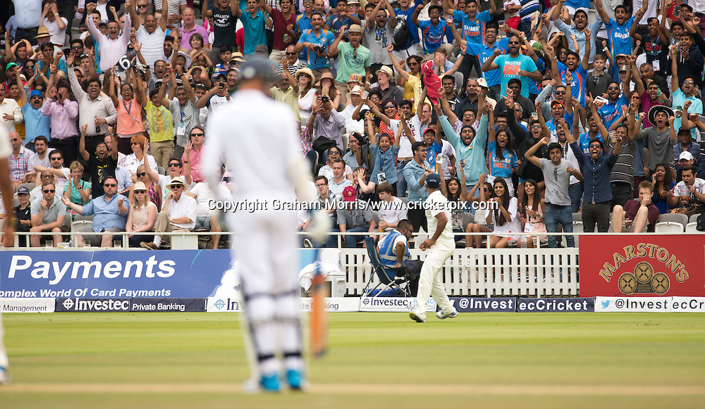 The visiting supporters erupt as Stuart Binny catches Joe Root off the bowling of Ishant Sharma during the second Investec Test Match between England and India at Lord's Cricket Ground, London. Photo: Graham Morris/www.cricketpix.com (Tel: +44 (0)20 8969 4192; Email: graham@cricketpix.com) 21/07/14
