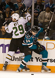December 11, 2009; San Jose, CA, USA; Dallas Stars center Steve Ott (29) is checked by San Jose Sharks left wing Jamie McGinn (64) during the first period at HP Pavilion. Dallas defeated San Jose 3-2 in the 11th round of a shootout. Mandatory Credit: Jason O. Watson / US PRESSWIRE