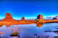 The Mittens in Monument Valley Reflecting Off A Rainwater Pool