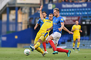 AFC Wimbledon Forward, James Hanson (18) and Portsmouth Defender, Matt Clarke (5) challenge for the ball during the Carabao Cup match between Portsmouth and AFC Wimbledon at Fratton Park, Portsmouth, England on 14 August 2018.