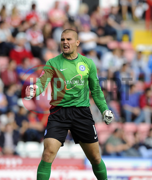 Peterborough United's Robert Olejnik celebrates  - Photo mandatory by-line: Joe Meredith/JMP - Tel: Mobile: 07966 386802 14/09/2013 - SPORT - FOOTBALL -  Ashton Gate - Bristol - Bristol City V Peterborough United - Sky Bet League One
