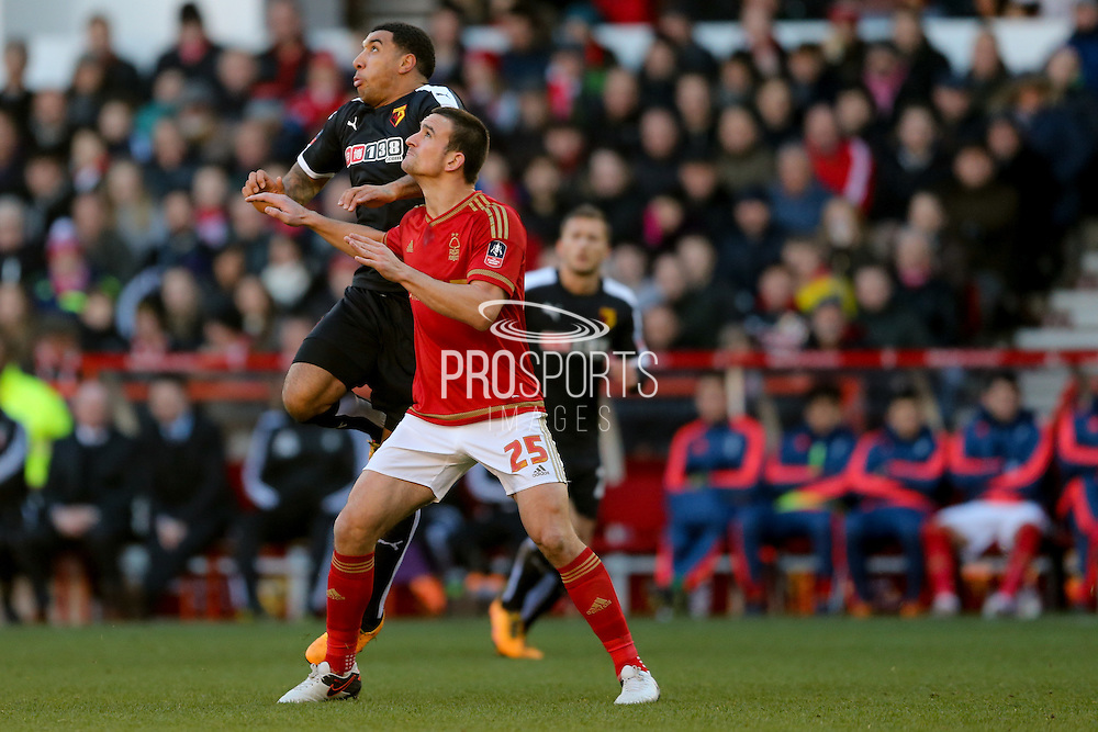 Watford forward Troy Deeney  and Nottingham Forest defender Jack Hobbs battle for the header during the The FA Cup fourth round match between Nottingham Forest and Watford at the City Ground, Nottingham, England on 30 January 2016. Photo by Simon Davies.