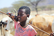 Kenya, Samburu Masai (Also Maasai) Tribesmen an ethnic group of semi-nomadic people. Young Maasai boy herding cattle