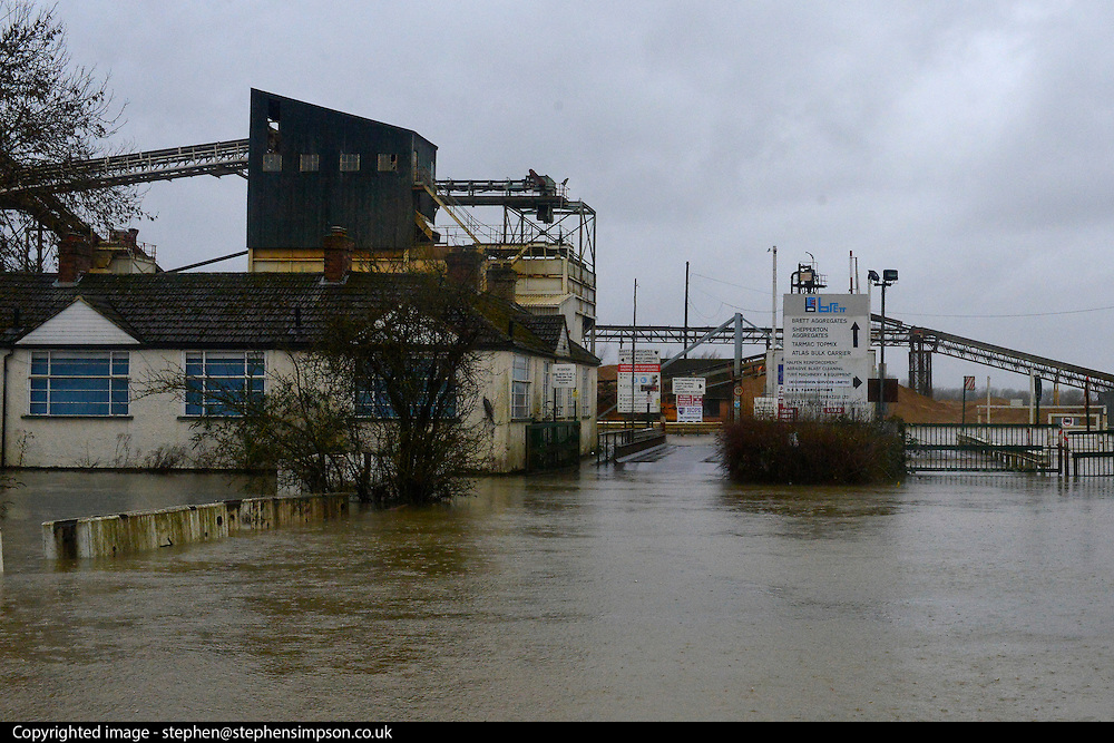 © Licensed to London News Pictures. 11/02/2014. Shepperton and Chertsey, UK. A flooded cement works in Shepperton.  Flooding in SHEPPERTON AND CHERTSEY in Surrey today 11th February 2014 after the River Thames burst its banks. The Environment Agency has issued 14 Severe Flood Warnings alone the Thames. Photo credit : Stephen Simpson/LNP