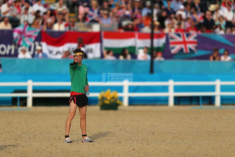 A competitor warms up prior to the start of the shooting and running portion of the men's modern pentathlon during day 15 of the London Olympic Games in London, England, United Kingdom on August 11, 2012..(Jed Jacobsohn/for The New York Times)..