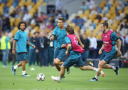 May 25, 2018 - Kiev, Ukraine - Real Madrid's Portuguese forward Cristiano Ronaldo kicks the ball during a Real Madrid team training session at the Olympic Stadium in Kiev, Ukraine on May 25, 2018, on the eve of the UEFA Champions League final football match between Liverpool and Real Madrid. (Credit Image: © Raddad Jebarah/NurPhoto via ZUMA Press)