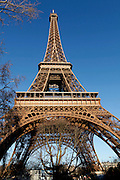 Eiffel Tower, March 31, 1889 (Universal Exhibition in celebration of the French Revolution), Alexandre Gustave Eiffel (1832-1923), 324 meters high, 10,100 tons, 18,038 pieces, 2,500,000 rivets, 1665 steps, seen on January 16, 2011 beneath a sunny afternoon, Paris, France. Picture by Manuel Cohen