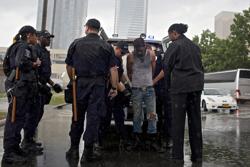 A protestor is arrested for covering his face with a mask near the 2012 Democratic National Convention in Charlotte, N.C. on Sept. 4, 2012. Photo by Greg Kahn