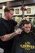 Jake Morisse, a barber at Bluejay's Barber Shop in Enid, Oklahoma, cuts the hair of one of his customers.