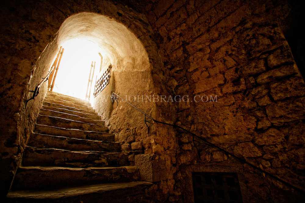 A stone arch stairway located  inside The Chateau de Chillon, Veytaux/Montreux, Switzerland.