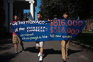 9/7/15 – Medford/Somerville, MA – Protesters march around Ballou Hall during Tufts Labor Coalition's and SEIU's rally and teach-in to raise awareness for recent janitorial staff cuts on Monday, Sep. 7, 2015. (Nicholas Pfosi / The Tufts Daily)