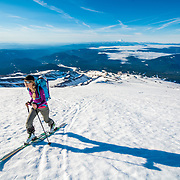 Noelle Synder skiing to the top of Mount Hood