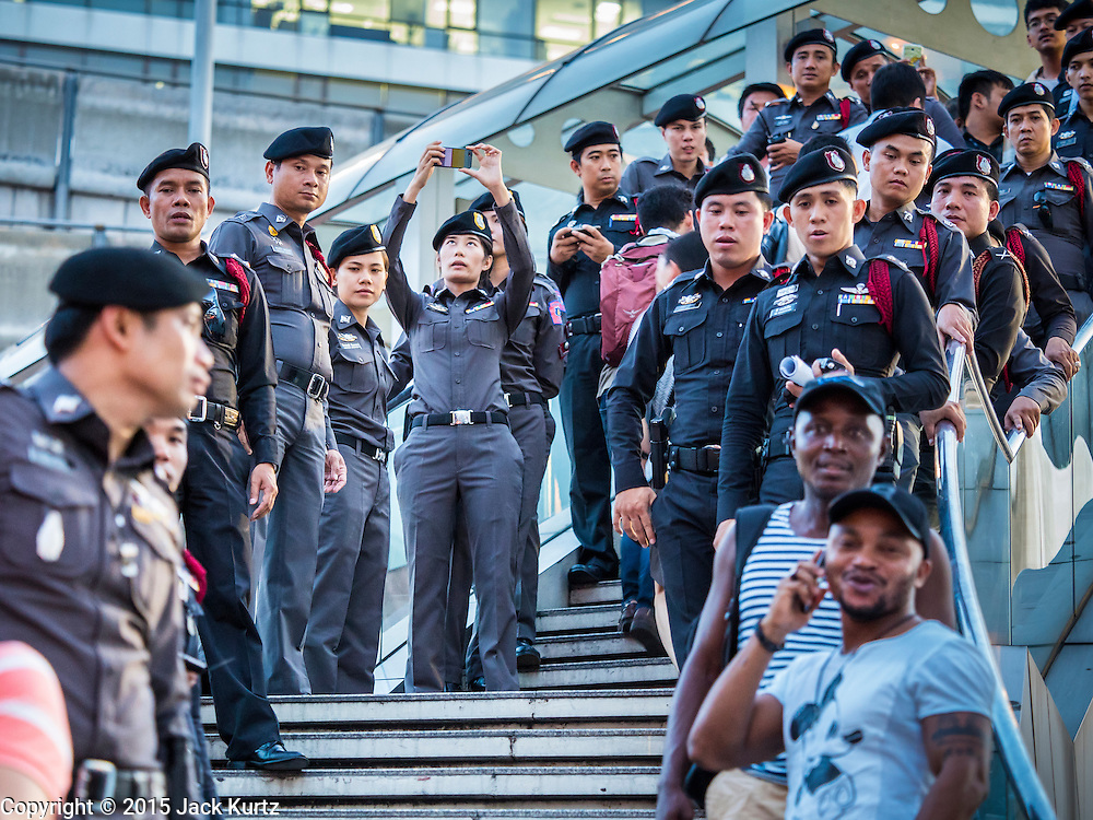 22 MAY 2015 - BANGKOK, THAILAND:  Thai police block the stairs to the National Stadium Skytrain station at the Bangkok Art and Culture Centre during an anti-coup protest. The Thai military seized power in a coup on May 22, 2014. There were small protests throughout Bangkok Friday to mark the first anniversary of the coup. Police arrested protestors at several locations. The most serious protest was at Bangkok Art and Culture Centre (BACC) where about 100 protestors, mostly students, faced off against police for several hours. Police made numerous arrests at the BACC protest.    PHOTO BY JACK KURTZ