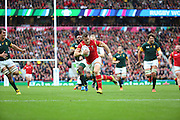 Wales Gareth Davies racing clear to score Wales first try during the Rugby World Cup Quarter Final match between South Africa and Wales at Twickenham, Richmond, United Kingdom on 17 October 2015. Photo by Matthew Redman.