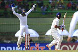 August 12, 2017 - Colombo, Sri Lanka - Indian batsman Ajinkya Rahane(R) gets bowled out during the 1st Day's play in the 3rd Test match between Sri Lanka and India at the Pallekele International cricket stadium, Kandy, Sri Lanka on Saturday 12 August 2017. (Credit Image: © Tharaka Basnayaka/NurPhoto via ZUMA Press)