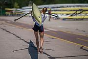 Plovdiv BULGARIA. 2017 FISA. Rowing World U23 Championships. <br /> USA BLW1X Molly PIERCE,  carries her boat back to the rack.<br /> Friday Boat Area. Boat Racks Pontoons.<br /> <br /> 12:25:45  Friday  21.07.17   <br /> <br /> [Mandatory Credit. Peter SPURRIER/Intersport Images].