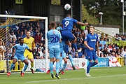 AFC Wimbledon striker Kweshi Appiah (9) with a header on goal during the EFL Sky Bet League 1 match between AFC Wimbledon and Coventry City at the Cherry Red Records Stadium, Kingston, England on 11 August 2018.