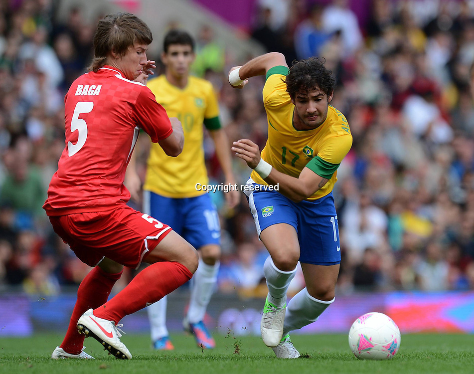 29.07.2012. London England, 2012 Olympic Games mens football. Preliminary group game Brazil versus Belarus.    Dmitry Baga left Belarus against Alexandre Pato Brazil