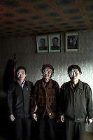 North Korea Eye Surgery Workshop. Three women from Kang Ryong recovering from their surgery in their guest house in central Haeju. The three had intra-occular lenses placed in the eyes that had cataract. Portraits of leaders late Kim IL Sung and current leader Kim Jong IL.