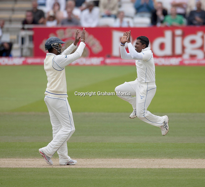 Kevin Pietersen is bowled by Rangana Herath (right, celebrating with close fielder Tharanga Paranavitana) during the second npower Test Match between England and Sri Lanka at Lord's.  Photo: Graham Morris (Tel: +44(0)20 8969 4192 Email: sales@cricketpix.com) 07/06/11
