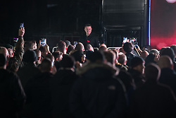 "© Licensed to London News Pictures . 03/11/2017 . Manchester , UK . TOMMY ROBINSON (real name Stephen Yaxley-Lennon ) speaks to supporters at the launch of the former EDL leader's book "" Mohammed's Koran "" at Castlefield Bowl . Originally planned as a ticket-only event at Bowlers Exhibition Centre , the launch was moved at short notice to a public location in the city . Photo credit : Joel Goodman/LNP"