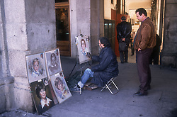 Plaza Mayor; Madrid; showing portrait painter with paintings,