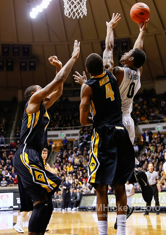 WEST LAFAYETTE, IN - JANUARY 27: Terone Johnson #0 of the Purdue Boilermakers shoots the ball against Roy Devyn Marble #4 of the Iowa Hawkeyes at Mackey Arena on January 27, 2013 in West Lafayette, Indiana. Purdue defeated Iowa 65-62 in overtime. (Photo by Michael Hickey/Getty Images) *** Local Caption *** Terone Johnson; Roy Devyn Marble