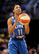 Sep 11, 2011; Phoenix, AZ, USA; Minnesota Lynx guard Candice Wiggins (11) shoots a free throw against the Phoenix Mercury during the first half at the US Airways Center.  The Lynx defeated the Mercury 96-90. Mandatory Credit: Jennifer Stewart-US PRESSWIRE