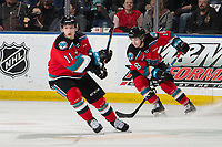 KELOWNA, BC - SEPTEMBER 28:  Kyle Crosbie #18 takes control of the puck from Pavel Novak #11 of the Kelowna Rockets against the Everett Silvertips  at Prospera Place on September 28, 2019 in Kelowna, Canada. (Photo by Marissa Baecker/Shoot the Breeze)