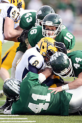 12 November 2011:  Antonio Owens gets gang tackled by Chris Simms, Kyle Pfister and Bret Swango during an NCAA division 3 football game between the Augustana Vikings and the Illinois Wesleyan Titans in Tucci Stadium on Wilder Field, Bloomington IL